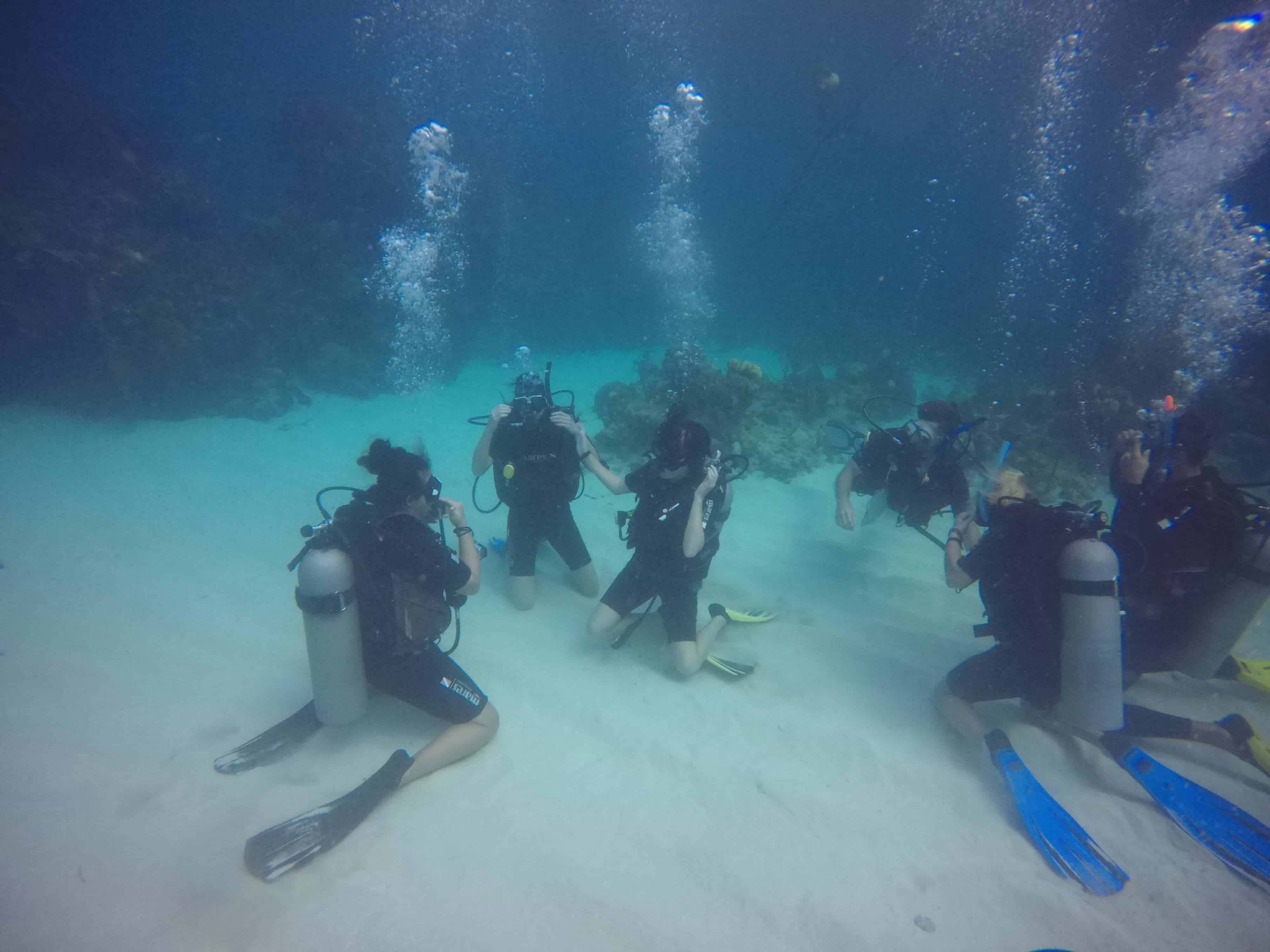 practicing skills underwater while diving in utila