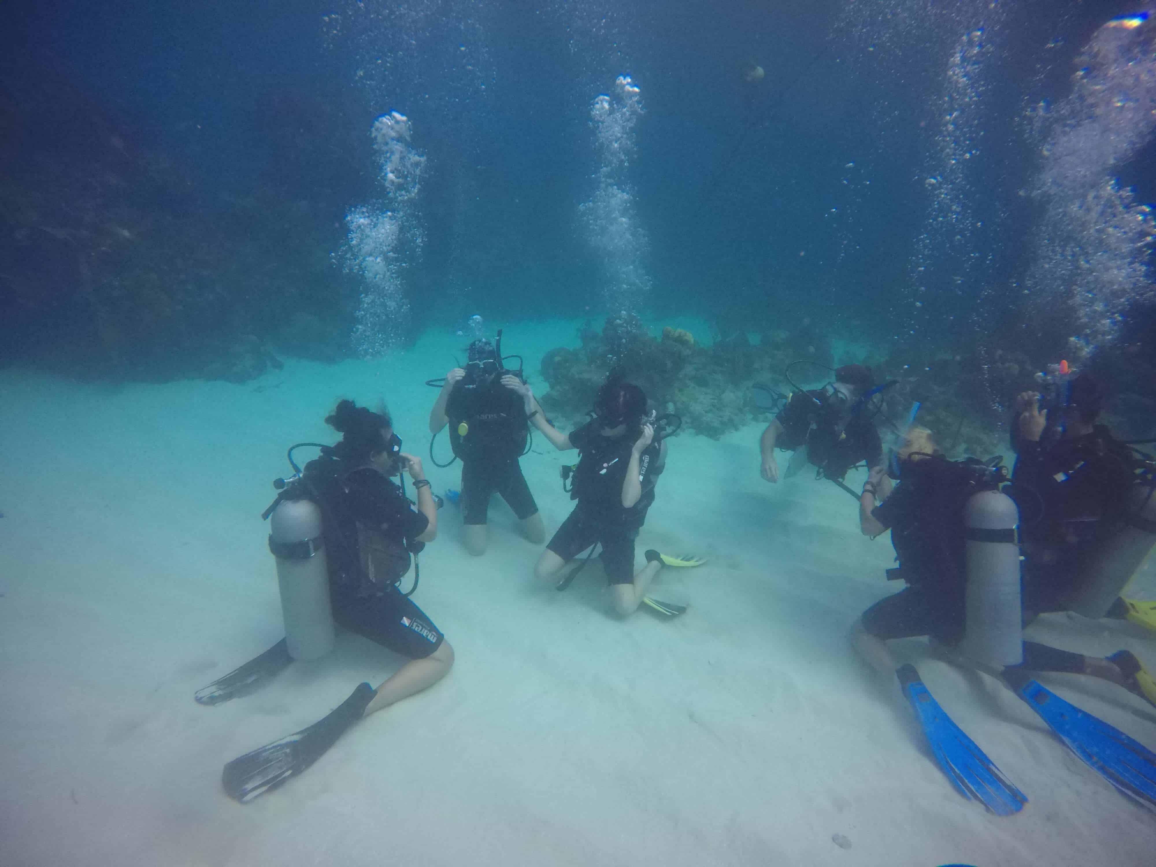 practicing skills underwater while diving in utila