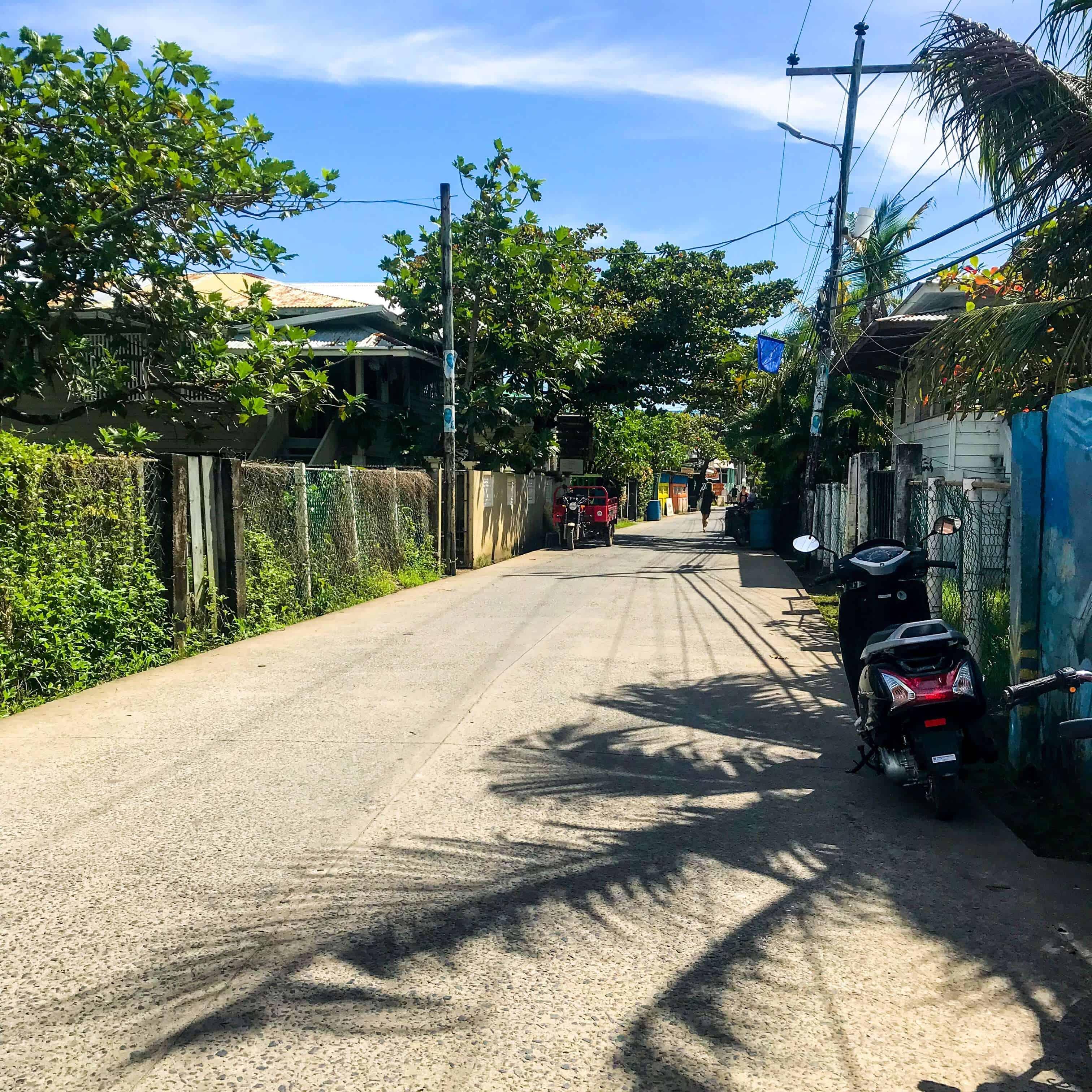 Walking down the street in Utila
