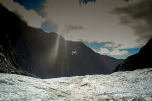 helicopter coming onto glacier