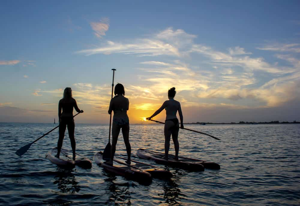 Paddle boarding at sunset in Utila, Honduras