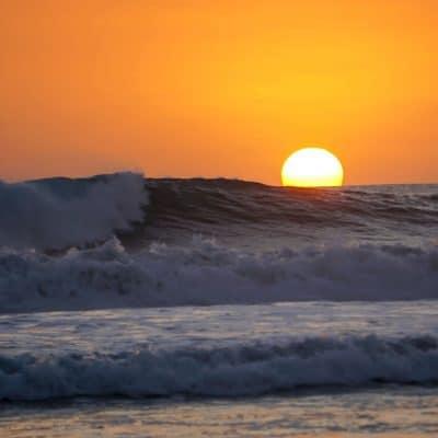 Sunset over the waves in Santa Teresa
