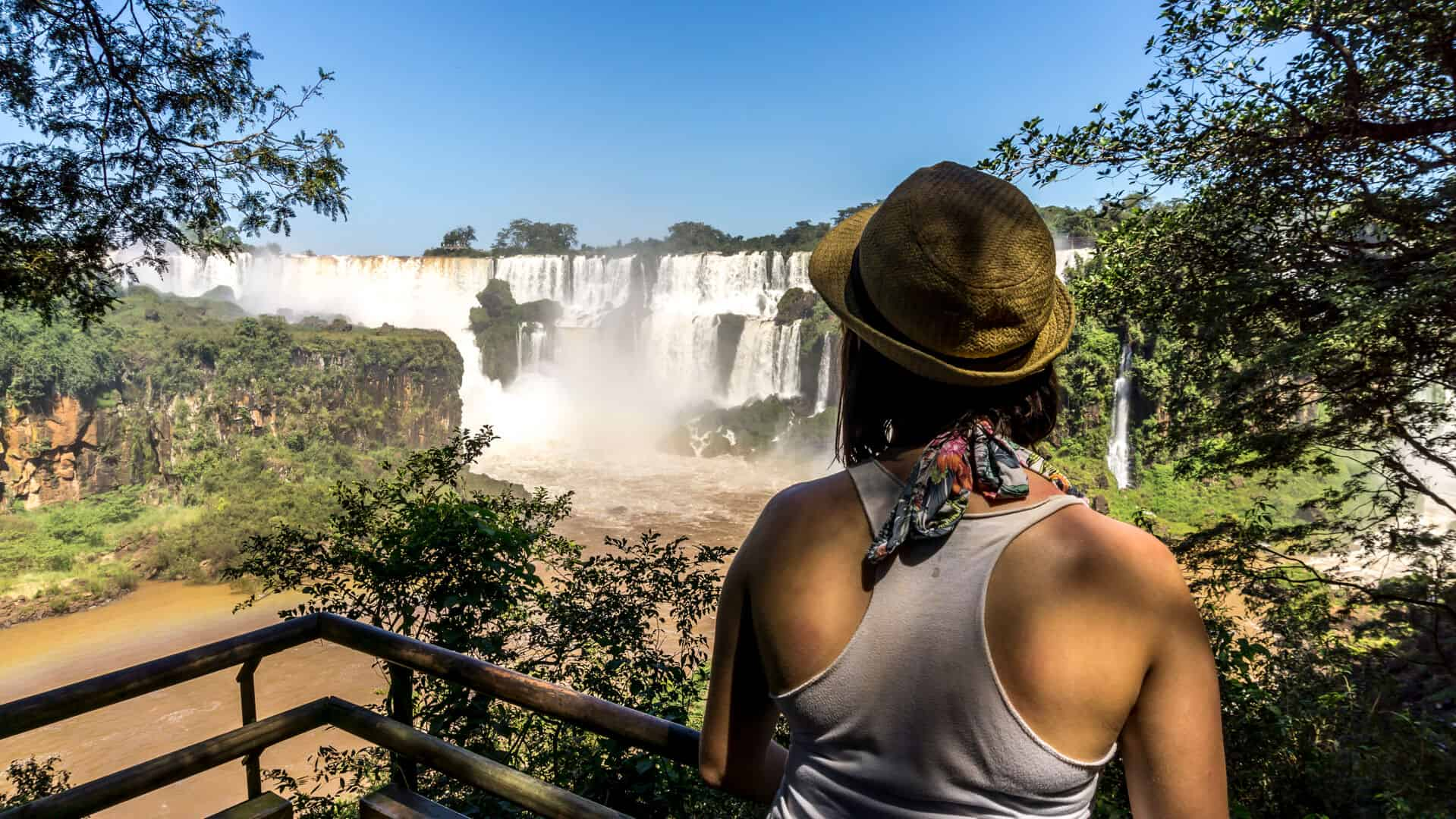 lora looking at iguazu falls