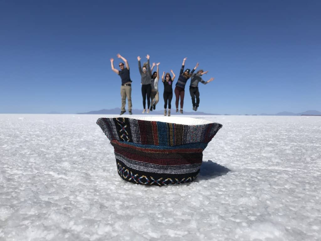 Jumping out of a hat on a Bolivia salt flats tour