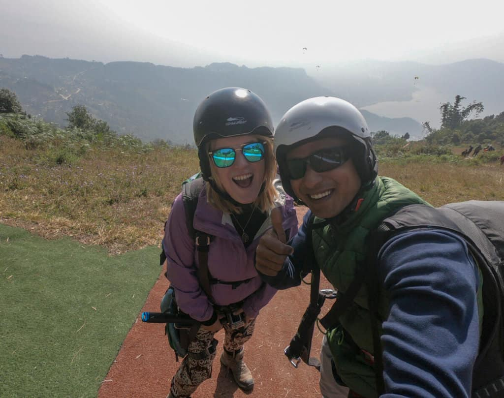 getting ready to go paragliding with guide