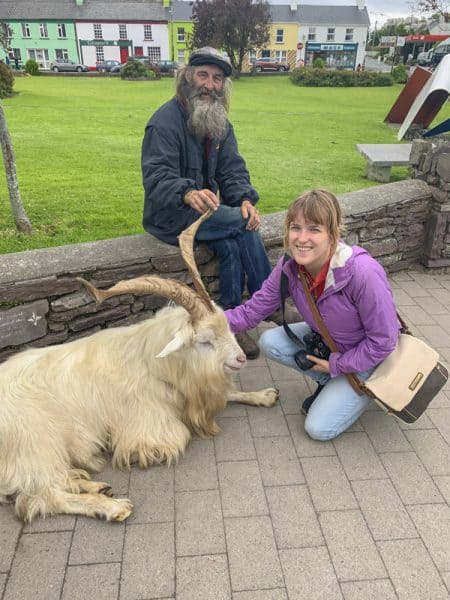 Petting a goat in ireland as a solo traveler