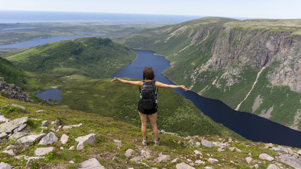 hiking at the summit of gros morne mountain