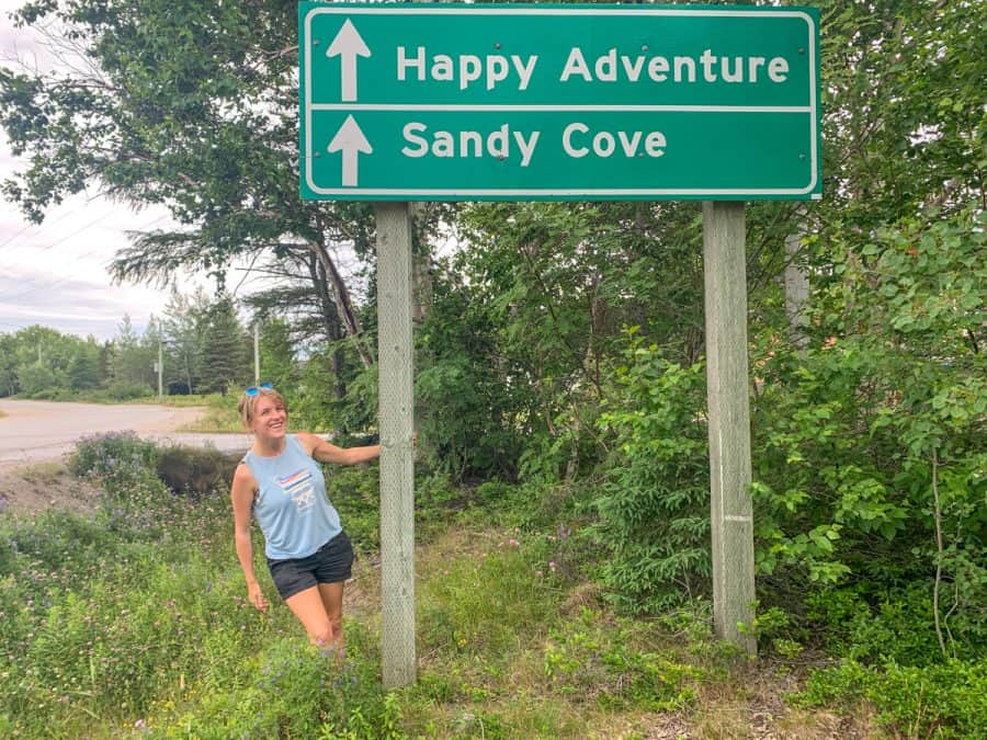 lora by happy adventure sandy cove sign road to the beaches