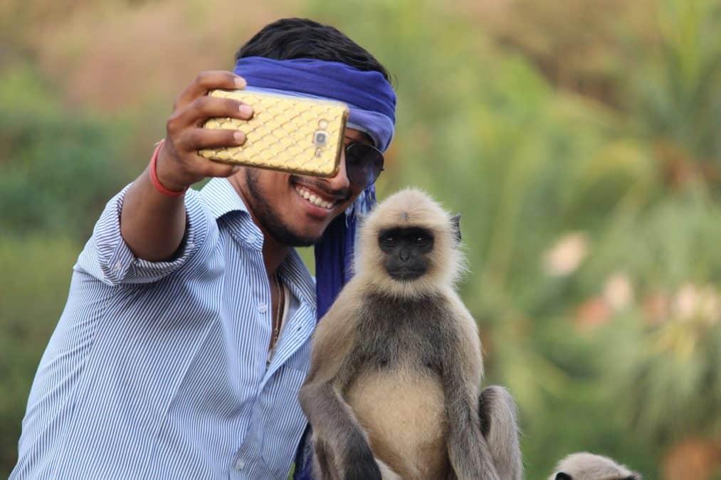 man taking a selfie with monkey