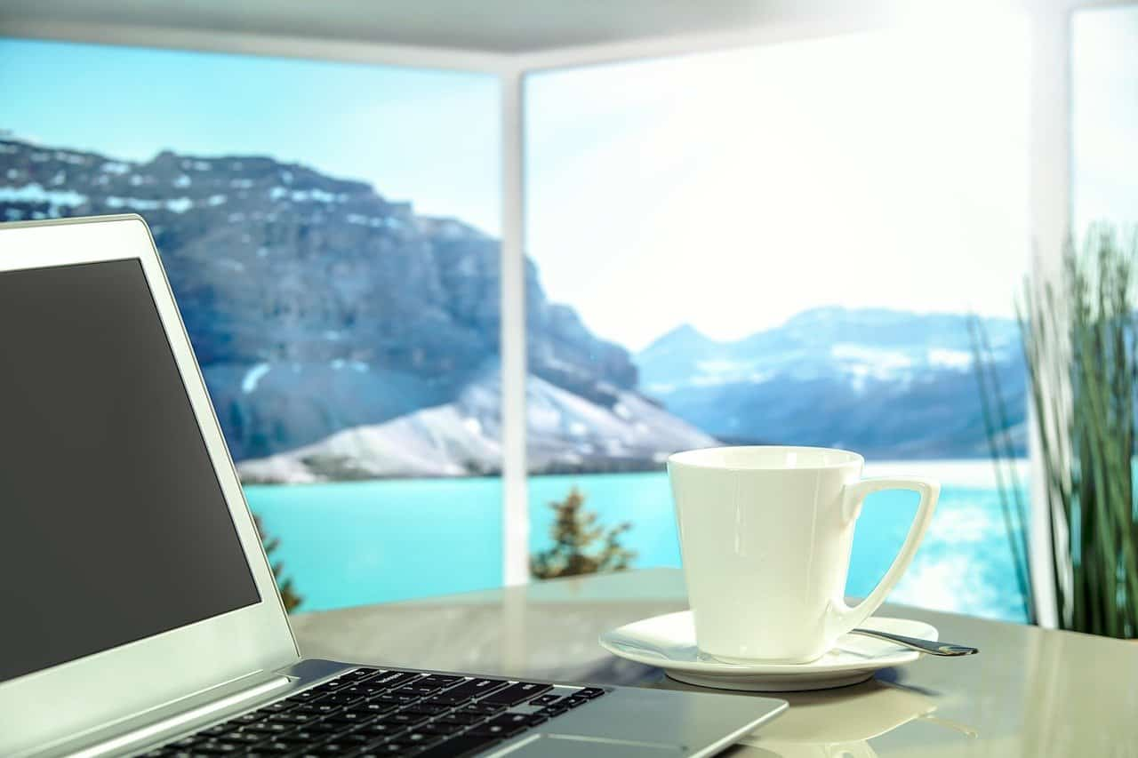 laptop in front of mountains