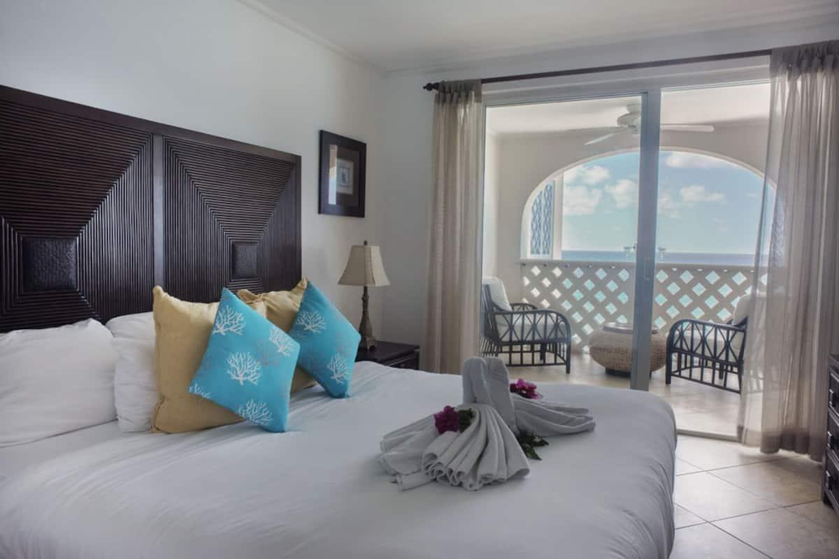 bed overlooking ocean views