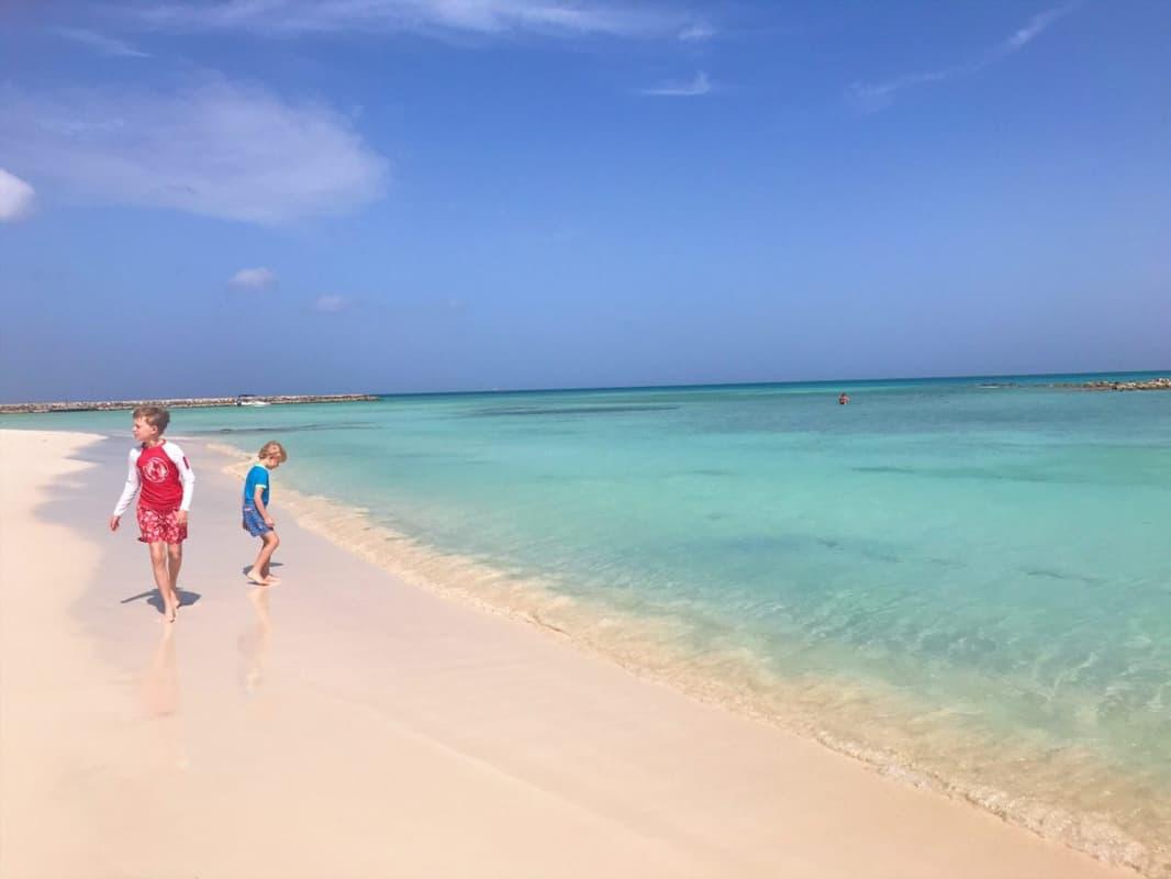 family walking on beach in Aruba