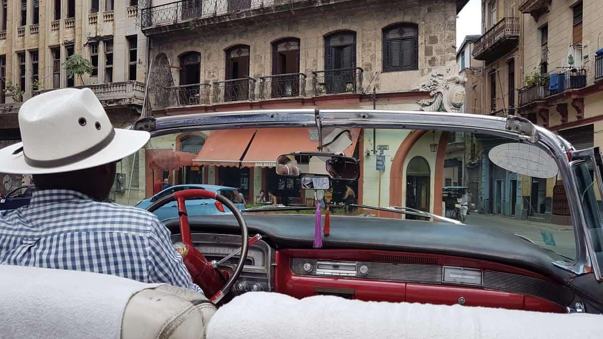 man driving car in cuba
