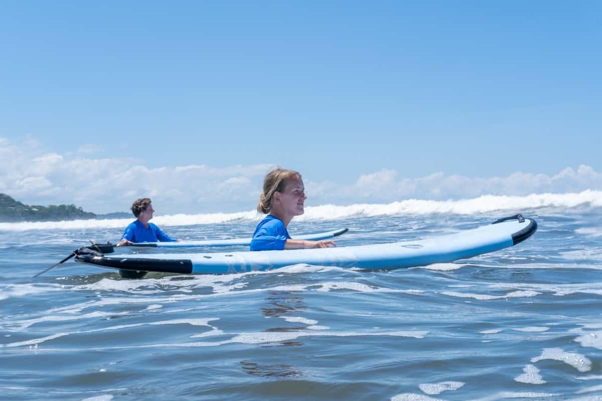 lora walking with surfboard