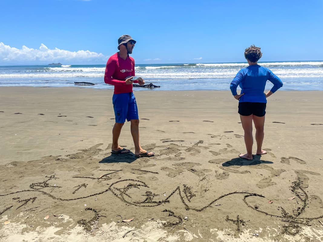 two people standing on beach