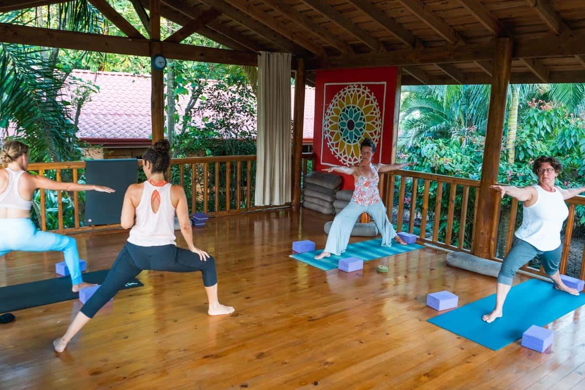 students holding yoga poses