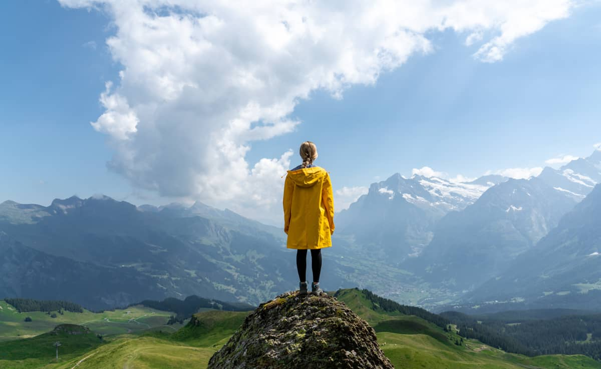 woman standing by mountains switzerland